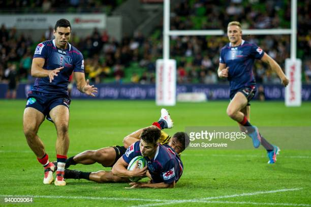 Jack Maddocks of the Melbourne Rebels is tackled by a Wellington Hurricanes player during Round 7 of the Super Rugby Series between the Melbourne...