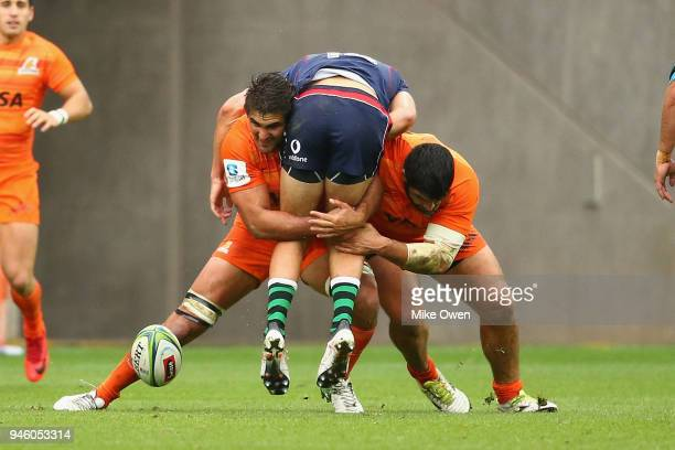 Jack Maddocks of the Rebals is tackled by Nahuel Tetaz Chaparro and Pablo Matera of the Jaguares during the round nine Super Rugby match between the...