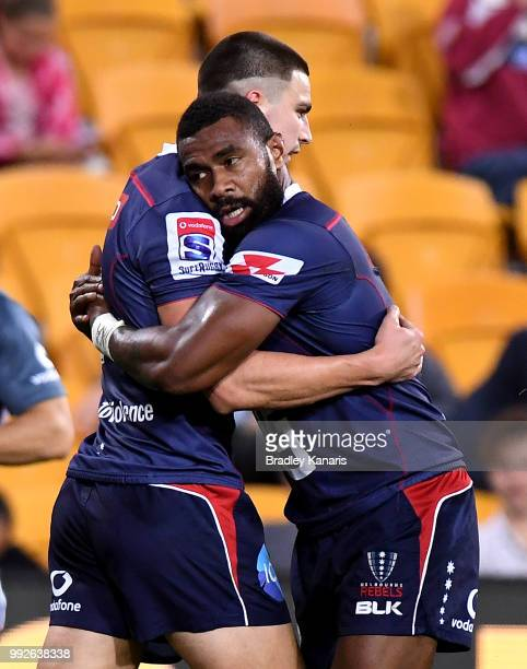 Jack Maddocks of the Rebels celebrates with team mates after scoring a try during the round 18 Super Rugby match between the Reds and the Rebels at...