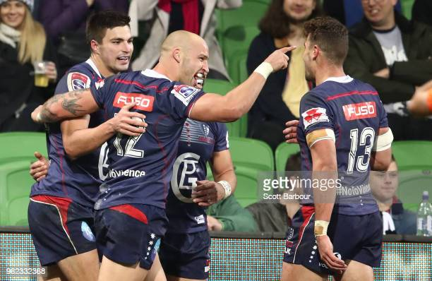 Jack Maddocks of the Rebels is congratulated by Bill Meakes and his teammates after scoring a try during the round 15 Super Rugby match between the...