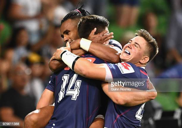 Jack Maddocks of the Rebels is congratulated by team mates after scoring a try during the round four Super Rugby match between the Rebels and the...