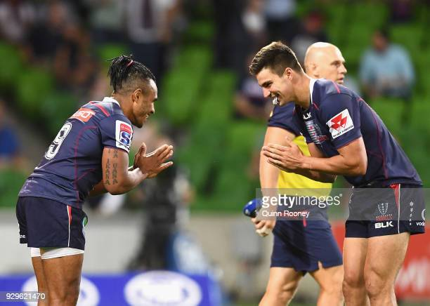 Jack Maddocks of the Rebels is congratulated by Will Genia after scoring a try during the round four Super Rugby match between the Rebels and the...