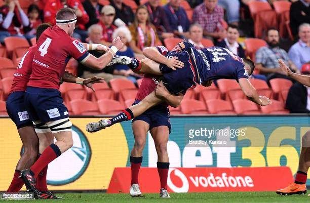 Jack Maddocks of the Rebels is picked up in the tackly by Hamish Stewart of the Reds during the round 18 Super Rugby match between the Reds and the...