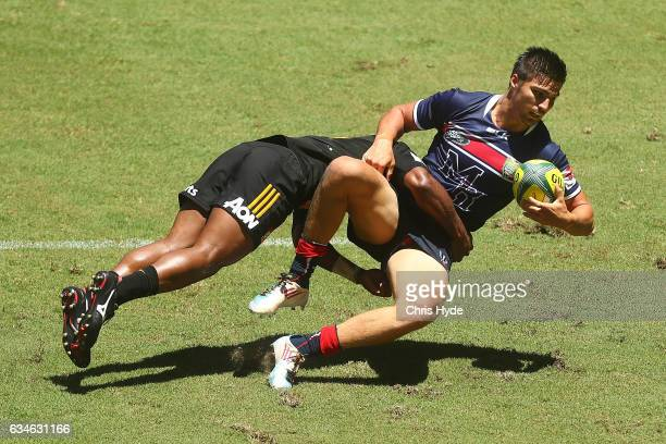 Jack Maddocks of the Rebels is tackled by Tauke'iaho of the Chiefs during the Rugby Global Tens match between Rebels and Chiefs at Suncorp Stadium on...