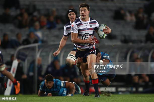 Jack Maddocks of the Rebels is tackled during the round 16 Super Rugby match between the Blues and the Rebels at Eden Park on June 2 2018 in Auckland...