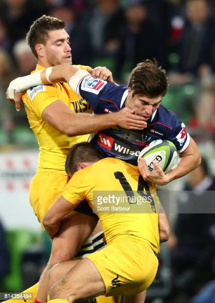 Jack Maddocks of the Rebels is tackled during the round 17 Super Rugby match between the Melbourne Rebels and the Jaguares at AAMI Park on July 14...
