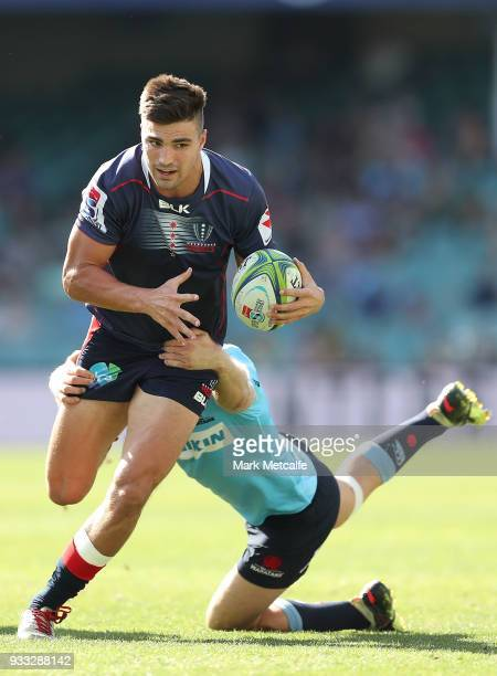 Jack Maddocks of the Rebels is tackled during the round five Super Rugby match between the Waratahs and the Rebels at Allianz Stadium on March 18...