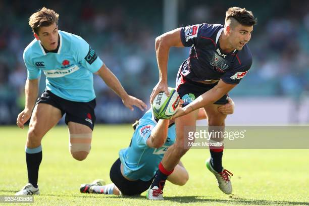 Jack Maddocks of the Rebels looks to offload during the round five Super Rugby match between the Waratahs and the Rebels at Allianz Stadium on March...