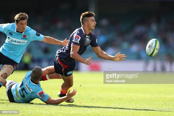 Jack Maddocks of the Rebels passes during the round five Super Rugby match between the Waratahs and the Rebels at Allianz Stadium on March 18 2018 in...
