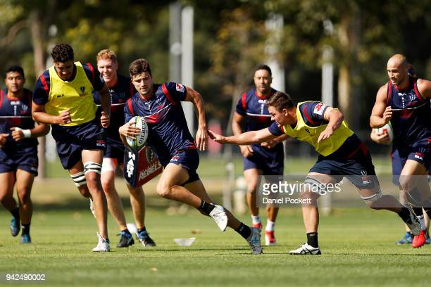 Jack Maddocks of the Rebels runs with the ball during a Melbourne Rebels Super Rugby training session at Goschs Paddock on April 6 2018 in Melbourne...