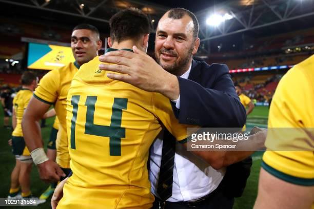 Jack Maddocks of the Wallabies is congratulated by Wallabies coach Michael Cheika after winning The Rugby Championship match between the Australian...