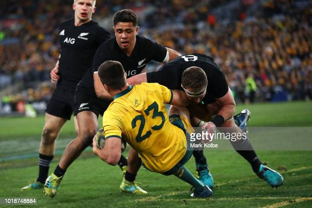 Jack Maddocks of the Wallabies is tackled Kieran Read of the All Blacks during The Rugby Championship Bledisloe Cup match between the Australian...