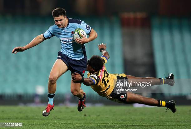 Jack Maddocks of the Waratahs evades the tackle of Marcel Brache of the Force during the round 2 Super Rugby AU match between the Waratahs and the...