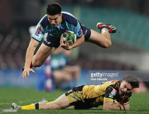 Jack Maddocks of the Waratahs Is tackled by Jack McGregor of the Force during the round 2 Super Rugby AU match between the Waratahs and the Western...