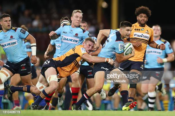 Jack Maddocks of the Waratahs Is tackled during the round 7 Super RugbyAU match between the NSW Waratahs and the ATC Brumbies at Sydney Cricket...