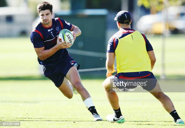 Jack Maddocks runs the ball during a Melbourne Rebels Super Rugby training session at Gosch's Paddock on February 26 2018 in Melbourne Australia