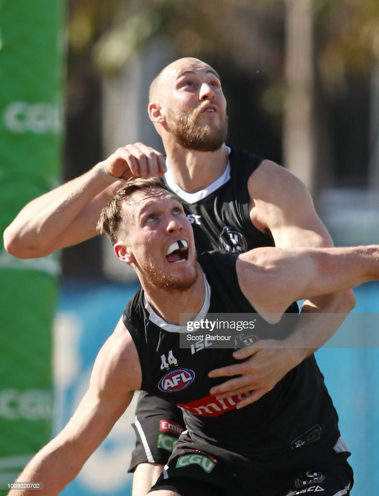 Jack Madgen of the Magpies and Ben Reid of the Magpies compete for the ball during a Collingwood magpies AFL media session at the Holden Centre on August 2, 2018 in Melbourne, Australia.