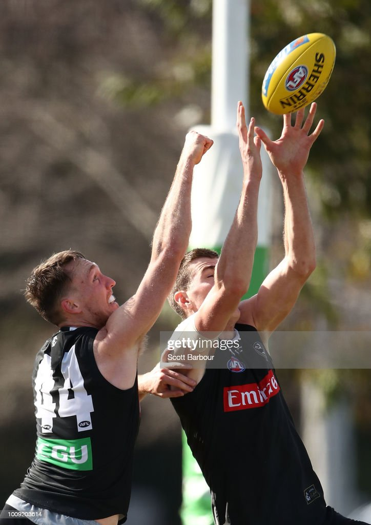 Jack Madgen of the Magpies and Mason Cox of the Magpies compete for the ball during a Collingwood magpies AFL media session at the Holden Centre on August 2, 2018 in Melbourne, Australia.