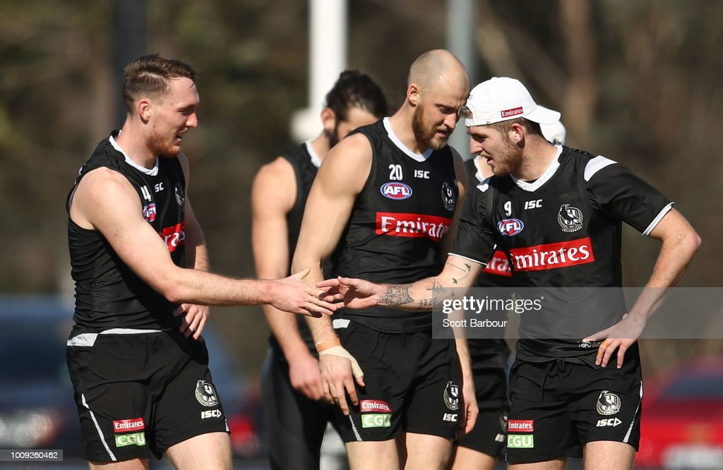 Jack Madgen of the Magpies and Sam Murray of the Magpies talk during a Collingwood magpies AFL media session at the Holden Centre on August 2, 2018 in Melbourne, Australia.