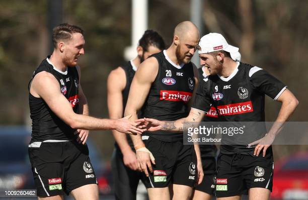 Jack Madgen of the Magpies and Sam Murray of the Magpies talk during a Collingwood magpies AFL media session at the Holden Centre on August 2 2018 in...