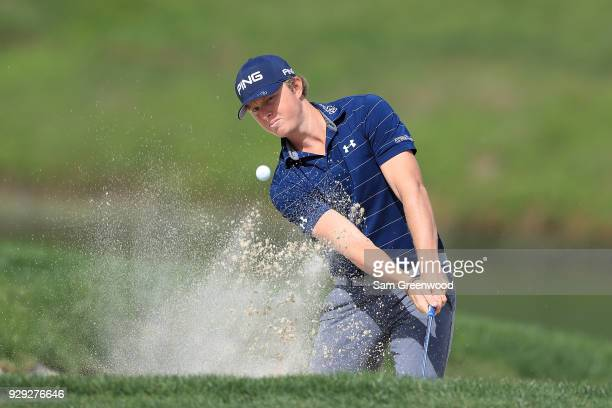 Jack Maguire plays a shot from a bunker on the 14th hole during the first round of the Valspar Championship at Innisbrook Resort Copperhead Course on...