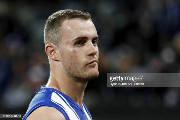 Jack Mahony of the Kangaroos reacts after a loss during the 2021 AFL Round 05 match between the Geelong Cats and the North Melbourne Kangaroos at...