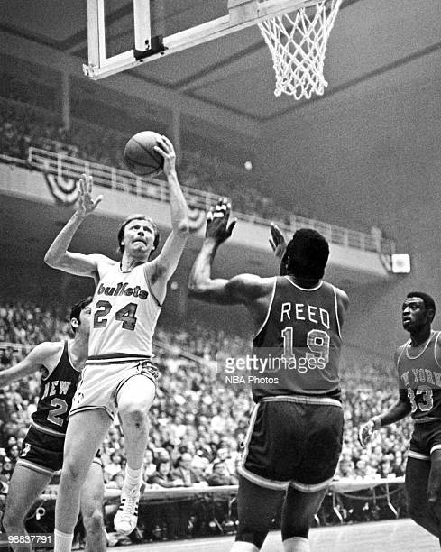 Jack Marin of the Baltimore Bullets shoots against Willis Reed of the New York Knicks during a game played circa 1969 at the Baltimore Coliseum in...