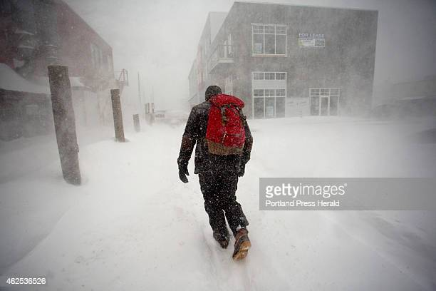 Jack Marrie makes his way to his 30foot fiberglass ketch named Rime where he lives yearround during a blizzard Tuesday January 27 2015 Marrie said he...
