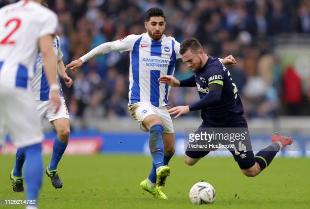Jack Marriott of Derby County is challenged by Alireza Jahanbakhsh of Brighton and Hove Albion during the FA Cup Fifth Round match between Brighton...