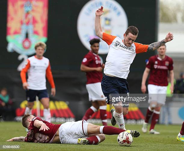 Jack Marriott of Luton Town evades the challenge of James Collins of Northampton Town during the Sky Bet League Two match between Northampton Town...