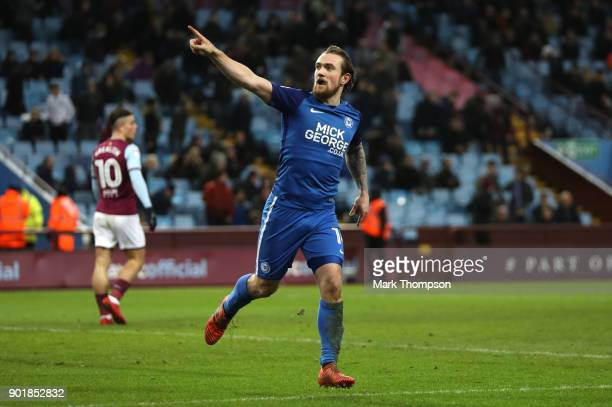 Jack Marriott of Peterborough United celebrates scoring his team's third goal during The Emirates FA Cup Third Round match between Aston Villa and...