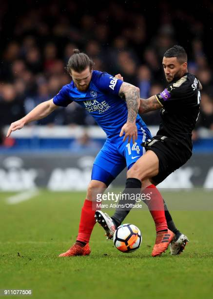Jack Marriott of Peterborough United in action with Danny Simpson of Leicester City the FA Cup 4th Round match between Peterborough United and...