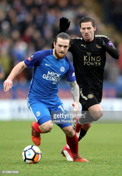 Jack Marriott of Peterborough United is challenged by Adrien Silva during The Emirates FA Cup Fourth Round match between Peterborough United and...