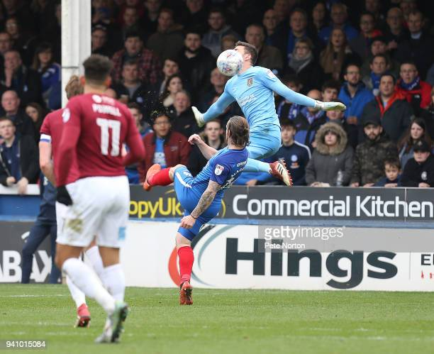 Jack Marriott of Peterborough United lifts the ball over Richard O'Donnell of Northampton Town to score his sides second goal during the Sky Bet...