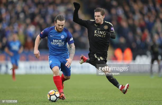 Jack Marriott of Peterborough United tangles with Adrien Silva of Leicester City during the Emirates FA Cup Fourth Roundat ABAX Stadium on January 27...