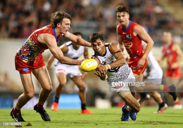 Jack Martin of the Blues handballs during the round 13 AFL match between the Gold Coast Suns and the Carlton Blues at TIO Stadium on August 21, 2020...