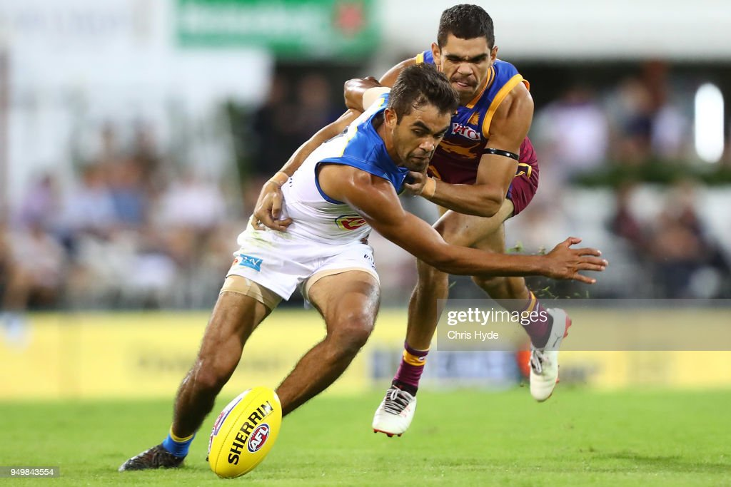 Jack Martin of the Suns and Charlie Cameron of the Lions compete for the ball during the round five AFL match between the Brisbane Lions and the Gold Coast Suns at The Gabba on April 22, 2018 in Brisbane, Australia.