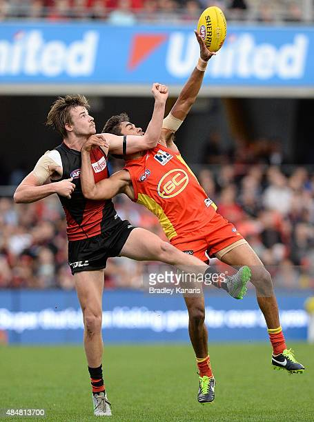 Jack Martin of the Suns and Martin Gleeson of the Bombers compete for the ball during the round 21 AFL match between the Gold Coast Suns and the...