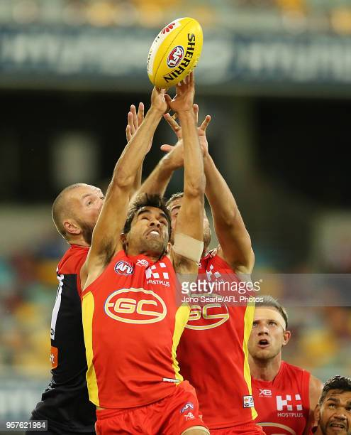 Jack Martin of the Suns attempts a mark during the round eight AFL match between the Gold Coast Suns and the Melbourne Demons at The Gabba on May 12...