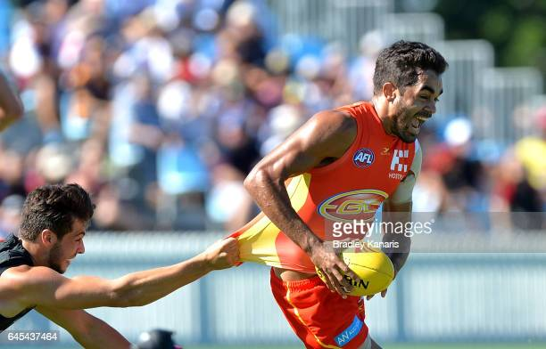 Jack Martin of the Suns breaks away from the defence during the JLT Community Series AFL match between the Gold Coast Suns and the Essendon Bombers...