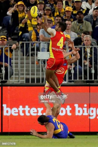 Jack Martin of the Suns flies over Jeremy McGovern of the Eagles during the round four AFL match between the West Coast Eagles and the Gold Coast...