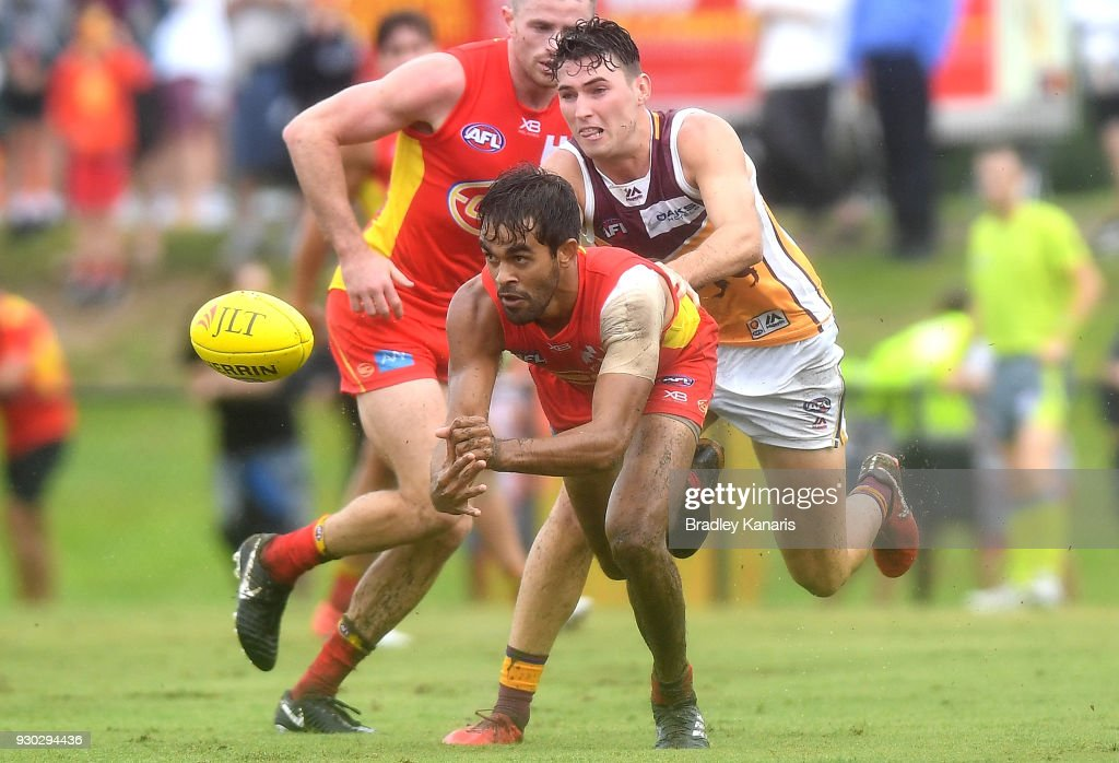 Jack Martin of the Suns gets a handball away during the JLT Community Series AFL match between the Gold Coast Suns and the Brisbane Lions at Fankhauser Reserve on March 11, 2018 in Brisbane, Australia.