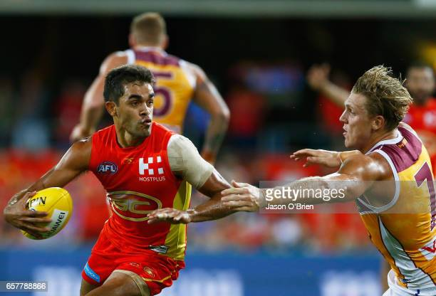 Jack Martin of the Suns in action during the round one AFL match between the Gold Coast Suns and the Brisbane Lions at Metricon Stadium on March 25,...