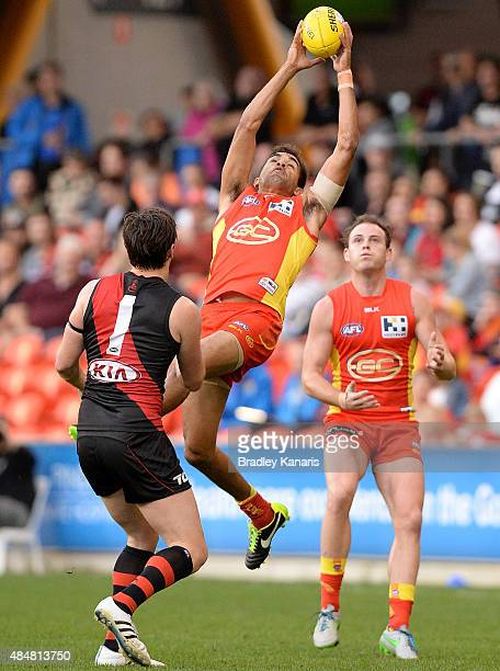 Jack Martin of the Suns takes a mark during the round 21 AFL match between the Gold Coast Suns and the Essendon Bombers at Metricon Stadium on August...