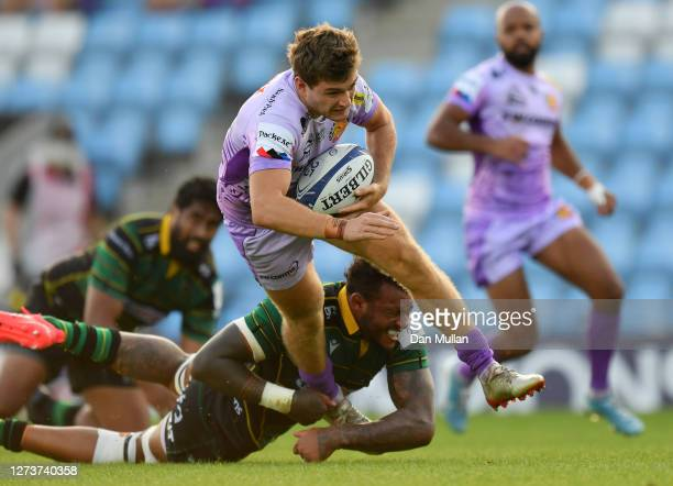 Jack Maunder of Exeter Chiefs breaks the tackle of Courtney Lawes of Northampton Saints to score his side's first try during the Heineken Champions...