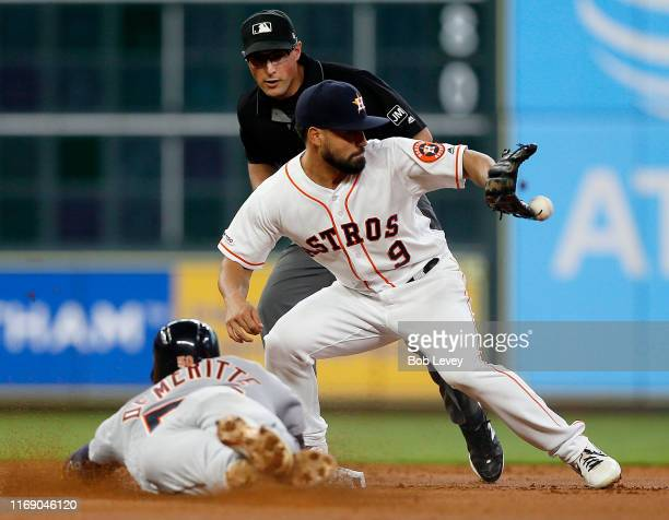 Jack Mayfield of the Houston Astros receives the throw from George Springer to tag out Travis Demeritte of the Detroit Tigers in the first inning at...