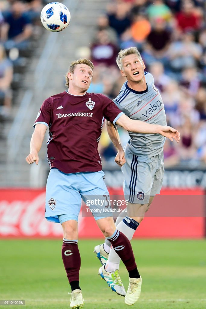Jack McBean #32 of Colorado Rapids and Bastian Schweinsteiger #31 of Chicago Fire reach for a header at Dick's Sporting Goods Park on June 13, 2018 in Commerce City, Colorado.