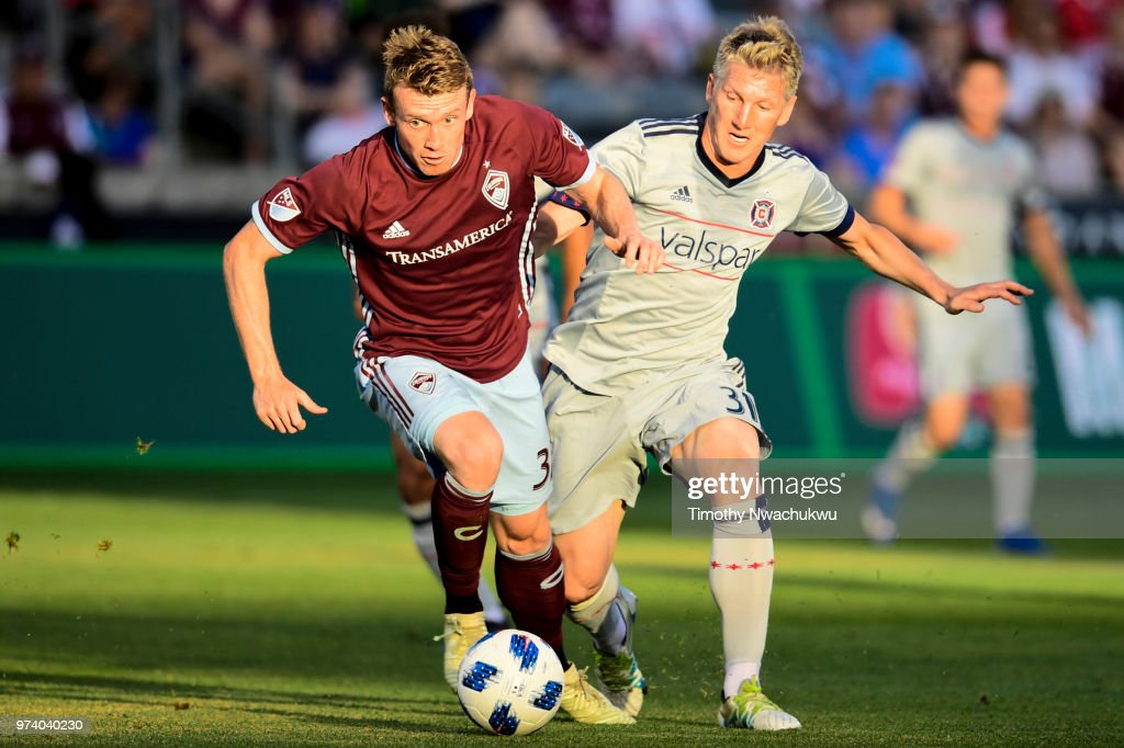 Jack McBean #32 of Colorado Rapids dribbles past Bastian Schweinsteiger #31 of Chicago Fire at Dick's Sporting Goods Park on June 13, 2018 in Commerce City, Colorado.