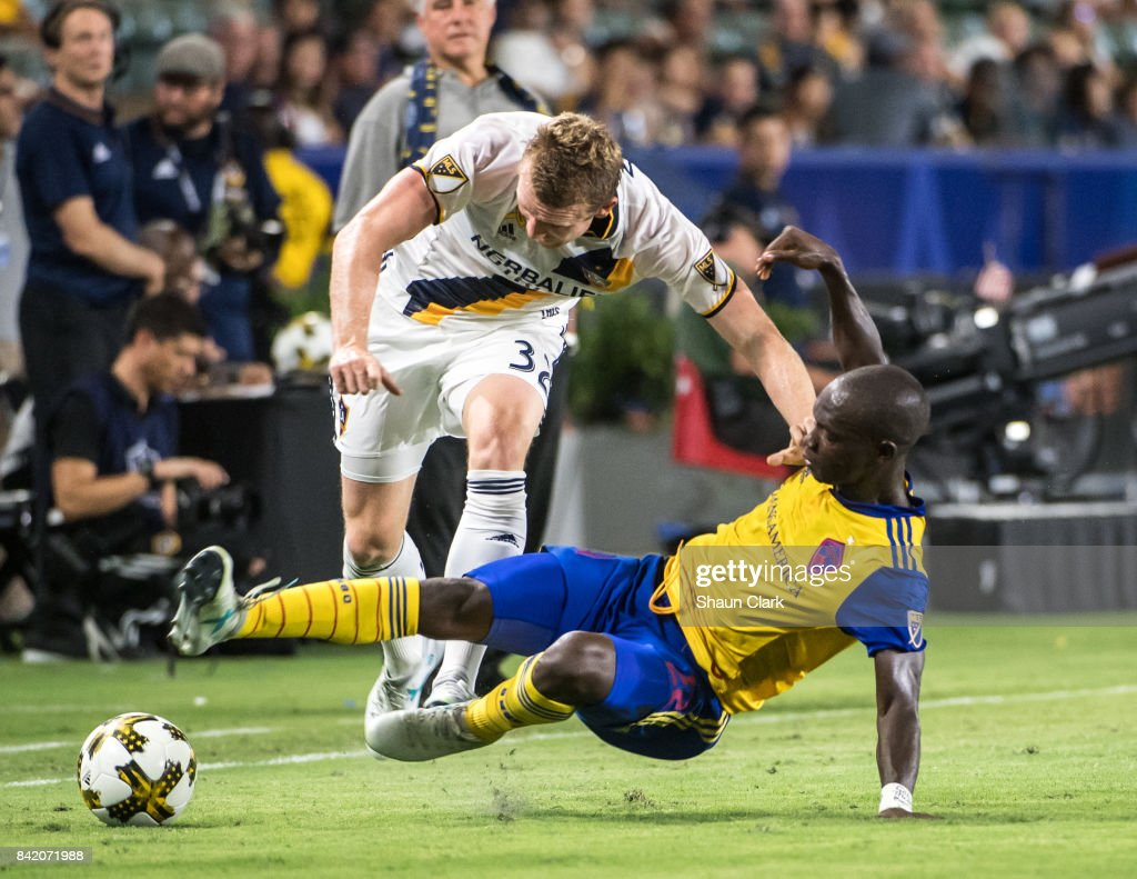 Jack McBean #32 of Los Angeles Galaxy battles Michael Azira #22 of Colorado Rapids during the Los Angeles Galaxy's MLS match against Colorado Rapids at the StubHub Center on September 2, 2017 in Carson, California. Los Angeles Galaxy won the match
