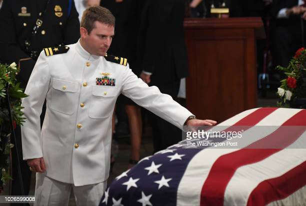 Jack McCain reaches out to touch the casket of his father lateSen John S McCain as he lies in state during a ceremony to honor the sixterm senator...